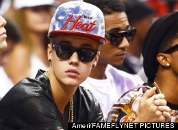 Justin Bieber is making headlines again for more bad behavior. Here, he attends a Miami Heat game in June. (Ameri/FAMEFLYNET PICTURES)