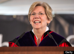 Sen. Elizabeth Warren (D-Mass.) was presiding over the Senate as the chamber confirmed Richard Cordray to head the CFPB. (Photo by Aram Boghosian for The Boston Globe via Getty Images)