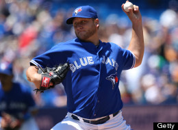 Mark Buehrle of the Toronto Blue Jays delivers a pitch during MLB game action against the Tampa Bay Rays on July 20, 2013 at Rogers Centre in Toronto, Ontario, Canada. (Photo by Tom Szczerbowski/Getty Images)