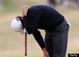 Australia's Adam Scott reacts after dropping a shot on the 13th green during the fourth and final round of the 2013 British Open Golf Championship at Muirfield golf course at Gullane in Scotland on July 21, 2013 . AFP PHOTO/PETER MUHLY        (Photo credit should read PETER MUHLY/AFP/Getty Images)
