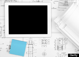 Digital Tablet, blueprints and sticker in office