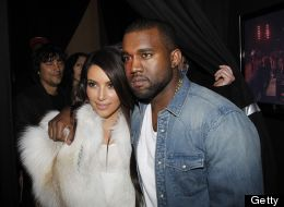 Kim Kardashian and Kanye West reportedly dropped major dough on some gold toilets. Here, they attend West's fashion show at Paris Fashion Week on March 6, 2012. (Michel Dufour/WireImage)