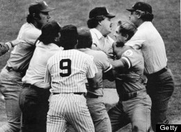 Baseball umpire Joe Brinkman (right) collars American baseball player George Brett of the Kansas City Royals in an effort to break up a fight started when Brett was ruled out after using an improper bat during a game against the New York Yankees at Yankee Stadium, New York, New York, July 24, 1983. (Photo by Bruce Bennett Studios/Getty Images)
