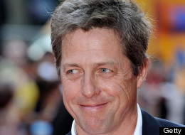 Hugh Grant attends the premiere of 'Alan Partidge: Alpha Papa' at Vue July 24, 2013 in London, England, showing off his naturally grey hair. (Photo by Gareth Cattermole/Getty Images)