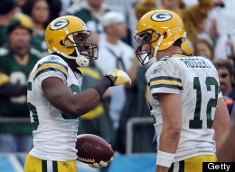 Greg Jennings #85 of the Green Bay Packers celebrates his touchdown catch with Aaron Rodgers #12 for a 44-24 lead over the San Diego Chargers during the fourth quarter at Qualcomm Stadium on November 6, 2011 in San Diego, California.  (Photo by Harry How/Getty Images)