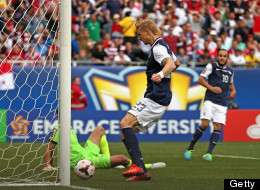 Brek Shea #23 of the United States scores the game-winning goal after a pass from Landon Donovan #10 past Jaime Penedo #1 of Panama during the CONCACAF Gold Cup final match at Soldier Field on July 28, 2013 in Chicago, Illinois.