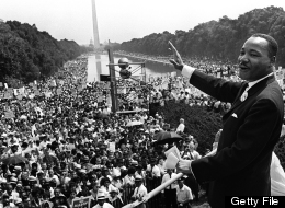 Martin Luther KIng (C) waves to supporters on August 28, 1963 on the Mall in Washington DC (Washington Monument in background) during the 'March on Washington'. (AFP/Getty Images)