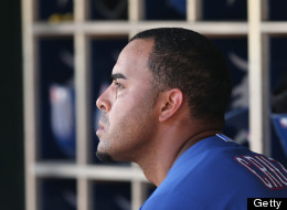 Nelson Cruz #17 of the Texas Rangers watches the action from the dugout during the eight innng of the game against the Detroit Tigers at Comerica Park on July 14, 2013 in Detroit, Michigan. The Tigers defeated the Rangers 5-0.  (Photo by Leon Halip/Getty Images)