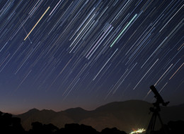 A bright meteor during Perseid meteor shower (Aug. 12 2012) is captured in a star trail image of constellation Orion