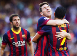 Barcelona's Lionel Messi is congratulated by Pedro after scoring against Levante at the Camp Nou stadium in Barcelona on August 18, 2013.