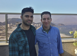 In this undated photo released by Janine Gibson of The Guardian, Guardian journalist Glenn Greenwald, right, and his partner David Miranda, are shown together at an unknown location. (AP Photo/Janine Gibson, the Guardian)