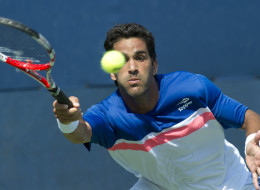 Maximo Gonzalez of Argentina returns to Jerzy Janowicz of Poland during their US Open 2013 men's singles match at the USTA Billie Jean King National Center August 27, 2013  in New York. AFP PHOTO/Don Emmert        (Photo credit should read DON EMMERT/AFP/Getty Images)