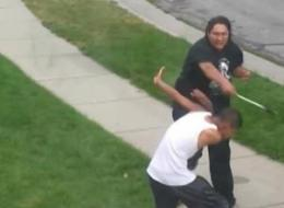 A still from raw video shows Phelan Silas, 23, swinging an axe at a teenager.