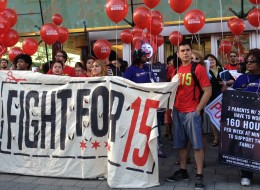 Protesters gathered outside the Rock N' Roll McDonald's at 600 N. Clark St. Thursday morning to protest the company's low wage practices. (Kim Bellware/Huffington Post)