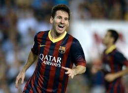 Lionel Messi festeja su tercer gol en el partido del Barcelona