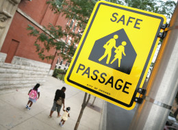 Students walk along a designated Safe Passage route to Laura Ward Elementary School on the West Side on August 28, 2013 in Chicago.