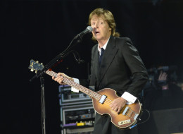 Paul McCartney (pictured performing in San Francisco Aug. 9) could be a costar along with Tom Hanks for one lucky philanthropist.  (Photo by C Flanigan/WireImage)