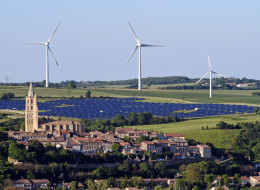 Wind turbines and a solar park are pictured on May 26, 2013 near the village of Avignonet-Lauragais, located southeast of Toulouse in the Midi-Pyrenees region. (REMY GABALDA/AFP/Getty Images)
