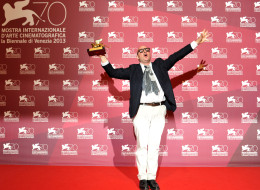 Director Gianfranco Rosi took the honor for