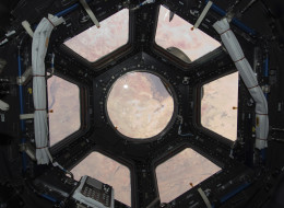 Sahara Desert visible through the windows of the cupola on the ISS Tranquility module