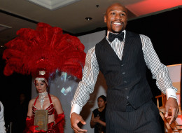 Floyd Mayweather Jr. walks on stage to accept the award for Male Fighter of the Year from Nevada at the Nevada Boxing Hall of Fame inaugural induction gala at the Monte Carlo Resort and Casino on August 10, 2013 in Las Vegas, Nevada.