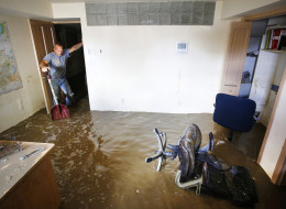 LONGMONT, CO - SEPTEMBER 16: Robert Pandolfi of Longmont, Colorado pauses for a moment while using a shovel to direct water in the basement of his boss' home as residents clean up in the wake of a week of heavy flooding on September 16, 2013 in Longmont, Colorado. More than 600 people are unaccounted for and thousands were forced to evacuate after historic flooding devastated communities in Colorado. (Photo by Marc Piscotty/Getty Images)