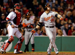 Chris Davis #19 of the Baltimore Orioles hits a home run in the 6th inning against the Boston Red Sox at Fenway Park on September 17 in Boston, Massachusetts. (Photo by Jim Rogash/Getty Images)
