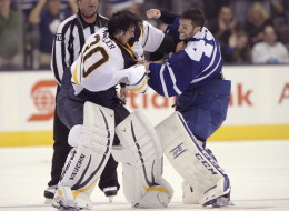 Leafs goalie Jonathan Bernier and Sabres goalie Ryan Miller fight during an NHL preseason game on Sunday. (Frank Gunn/CP)