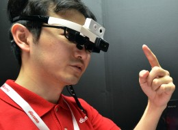 Japan's telecom giant NTT Docomo engineer wears a head mount display (HMD)