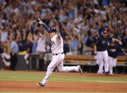 Jose Lobaton of theTampa Bay Rays reacts after hitting a game-winning home run against Koji Uehara of the Boston Red Sox in the ninth inning of Game Three of the American League Division Series on October 7, 2013 at Tropicana Field in St. Petersburg, Florida.
