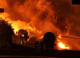 Rail cars on fire in Lax-Megantic, Que., July 5, 2013. An expert who examined the devastating train derailment in Lac-Megantic says no plans and equipment are in place to deal with a similar situation as the one-year anniversary of the tragedy approaches.