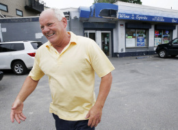 In this Thursday, June 6, 2013, file photo Stephen Rakes smiles after greeting an acquaintance outside the liquor store he once owned in the South Boston neighborhood of Boston. (AP Photo/Michael Dwyer, File)