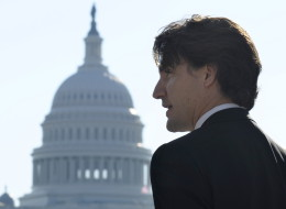 With the Capitol dome in the background, Canadian Liberal Leader Justin Trudeau speaks to reporters during his first official visit to Washington since becoming Liberal Leader on Oct. 25, in Washington. (AP Photo/Susan Walsh)