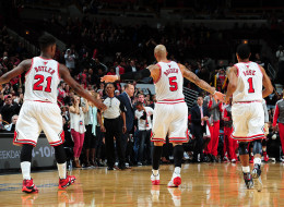 Carlos Boozer #5, Derrick Rose #1 and Jimmy Butler #21 of the Chicago Bulls give each other fives against of the Denver Nuggets on October 25, 2013 at the United Center in Chicago, Illinois. (Scott Cunningham/NBAE via Getty Images)