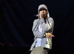 US rapper Eminem performs on August 22, 2013 during a concert at the Stade de France in Saints-Denis, near Paris.     AFP PHOTO / PIERRE ANDRIEU        (Photo credit should read PIERRE ANDRIEU/AFP/Getty Images)