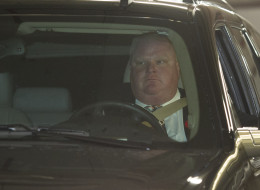 TORONTO, ON - NOVEMBER 5: Toronto Mayor Rob Ford drives out of the underground parking with an office assistant in the car with him on November 5, 2013. Ford had earlier addressed the media following this morning's admission of having smoked crack. Ford did not step down, and said the city business must go on.        (Rick Madonik/Toronto Star via Getty Images)