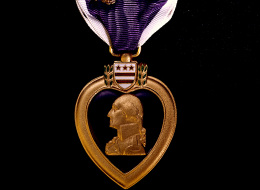 Closeup of Purple Heart, w. oak leaf clusters & image of Pres. George Washington, awarded US Army Lieut. Audie Murphy during WWII.  (Photo by A. Y. Owen//Time Life Pictures/Getty Images)