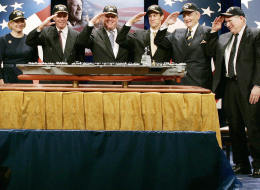 Washington, UNITED STATES:  Government officials and family members of former US President Gerald Ford salute a model of a new aircraft carrier named the USS Gerald R. Ford during a naming ceremony at the Pentagon in Washington, 16 January 2007. The nuclear-powered aircraft carrier CVN 78, which Cheney said will go into service in 7-8 years, will be the first in the new Gerald R. Ford class of aircraft carriers in the US Navy. (From L) are Secretary of the Navy Donald Winter, U.S. Vice President