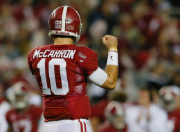 TUSCALOOSA, AL - NOVEMBER 09:  AJ McCarron #10 of the Alabama Crimson Tide celebrates a touchdown rush by T.J. Yeldon #4 in the third quarter against the LSU Tigers at Bryant-Denny Stadium on November 9, 2013 in Tuscaloosa, Alabama.  (Photo by Kevin C. Cox/Getty Images)