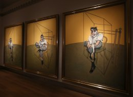 A cameraman films Francis Bacon's 'Three Studies of Lucien Freud' on display at Christie's on October 14, 2013 in London, England. (Photo by Peter Macdiarmid/Getty Images)