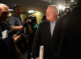 TORONTO, ON - NOVEMBER 13  - Mayor Rob Ford's surrounded by media leaves his office with security  and lawyer Dennis Morris at City Hall in Toronto on  November 13, 2013  (Vince Talotta/Toronto Star via Getty Images)