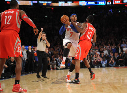 A personal foul is called on James Harden #13 of the Houston Rockets while  Carmelo Anthony #7 of the New York Knicks  takes a shot with five seconds left in the game at Madison Square Garden on November 14, 2013 in New York City. The Rockets defeat the Knicks 109-106. NOTE TO USER: User expressly acknowledges and agrees that, by downloading and/or using this photograph, user is consenting to the terms and conditions of the Getty Images License Agreement.  (Photo by Maddie Meyer/Getty Images)