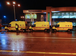 Ambulances queue in front of the airport building where the Russian passenger airliner, Boeing 737, crashed on Nov. 17, 2013 in Kazan, Russia.  (Photo by Mikhail Sokolov/Kommersant via Getty Images)