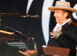US legend Bob Dylan gestures as he performs on stage during the 21st edition of the Vieilles Charrues music festival on July 22, 2012 in Carhaix-Plouguer, western France.  AFP PHOTO / FRED TANNEAU        (Photo credit should read FRED TANNEAU/AFP/GettyImages)