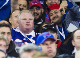 Toronto Mayor Rob Ford watches the Buffalo Bills play the Atlanta Falcons during the first half of NFL action in Toronto, Sunday December 1, 2013. THE CANADIAN PRESS/Mark Blinch