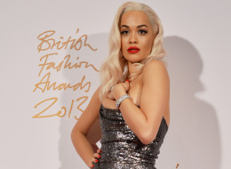 British singer-songwriter Rita Ora, presenter, poses at the British Fashion Awards in London on December 2, 2013. AFP PHOTO / BEN STANSALL        (Photo credit should read BEN STANSALL/AFP/Getty Images)