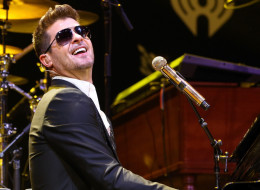DALLAS, TX - DECEMBER 02:  Recording artist Robin Thicke performs onstage during 106.1 KISS FM's Jingle Ball 2013 at American Airlines Center on December 2, 2013 in Dallas, Texas.  (Photo by Christopher Polk/Getty Images for Clear Channel)
