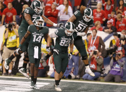 Josiah Price #82 of the Michigan State Spartans celebrates his fourth quarter touchdown catch with teammates against Ohio State during the Big 10 Conference Championship Game at Lucas Oil Stadium on December 7, 2013 in Indianapolis, Indiana.
