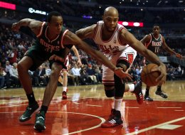 The Chicago Bulls' Taj Gibson controls the ball as the Milwaukee Bucks' John Henson, left, reaches in during the first quarter at United Center in Chicago on Tuesday, Dec. 10, 2013. (Scott Strazzante/Chicago Tribune/MCT via Getty Images)
