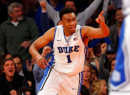 Jabari Parker #1 of the Duke Blue Devils reacts after dunking the ball in the second half against the UCLA Bruins during the CARQUEST Auto Parts Classic on December 19, 2013 at Madison Square Garden in New York City.  (Photo by Jim McIsaac/Getty Images)